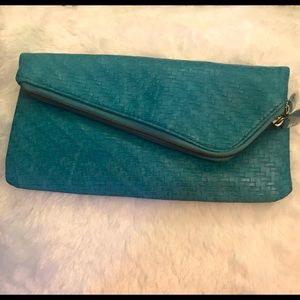 Cool turquoise asymmetrical clutch handbag!